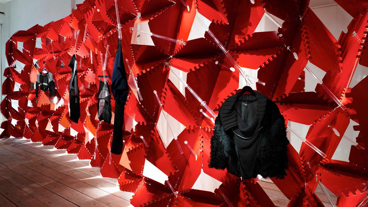 Futuristic clothing display looks like fabric under a - Fabric that looks like metal ...