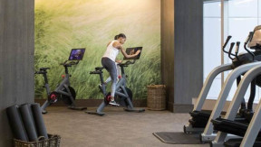Now you can order room service and work out on a Peloton bike all at the same time