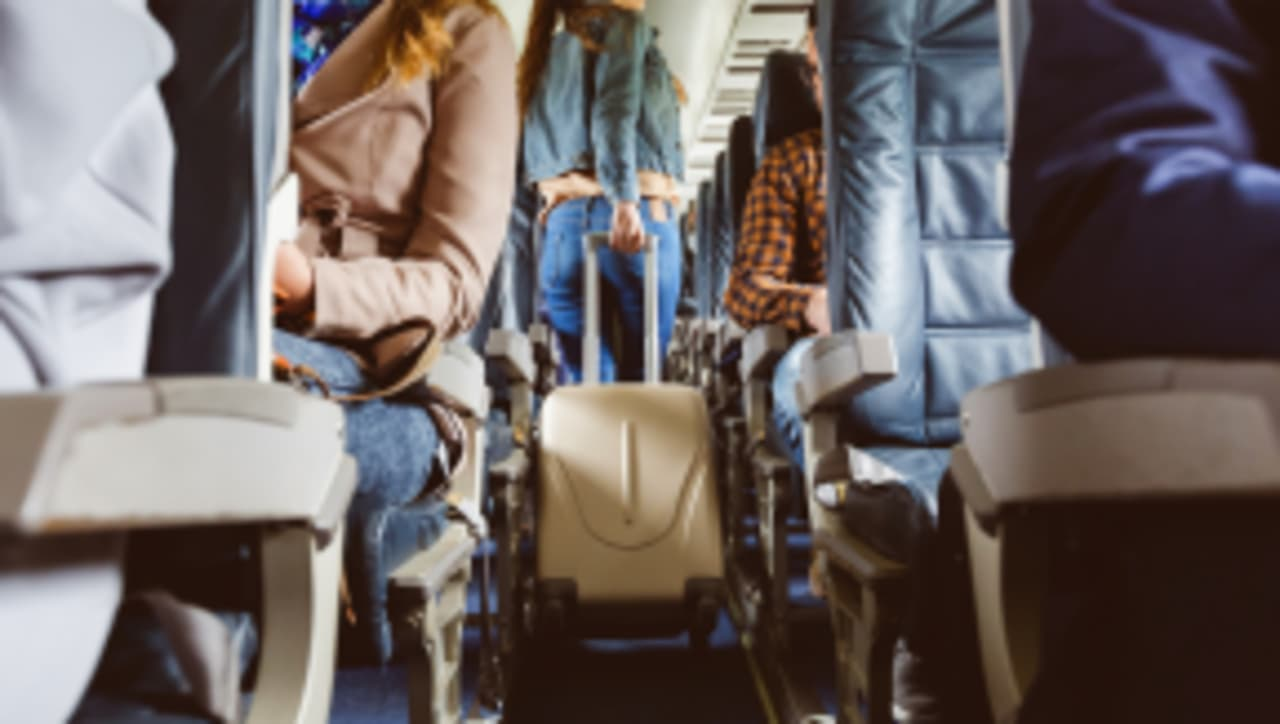 The Way We Board Planes Spreads More Disease