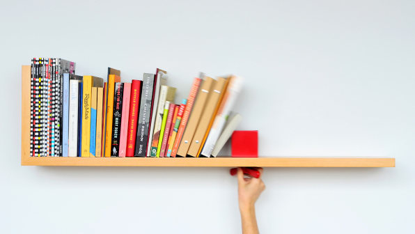Hold on Tight, by the Brooklyn design studio Colleen and Eric, is a wall-mounted  bookshelf with a book-locking mechanism built into it. - Wall-Mounted Shelf Prevents Toppling Books With Sliding Lock