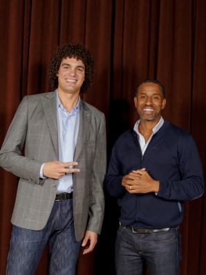 Verejao smiles for a photo with Hamet Watt, a partner at Upfront Ventures. Photos: Damien Maloney for Fast Company