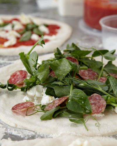 <p>At Del Popolo, $14 will get you a mozzarella, braised rapini, spicy salami, red onion, chili oil pie. For $10, tomato, fresh mozzarella, basil, extra virgin olive oil, sea salt.</p>