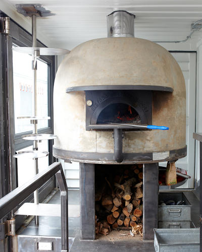 <p>The famed Ferrara family built the oven, a standard wood-burning brick dome that reaches up to 1,000 degrees.</p>
