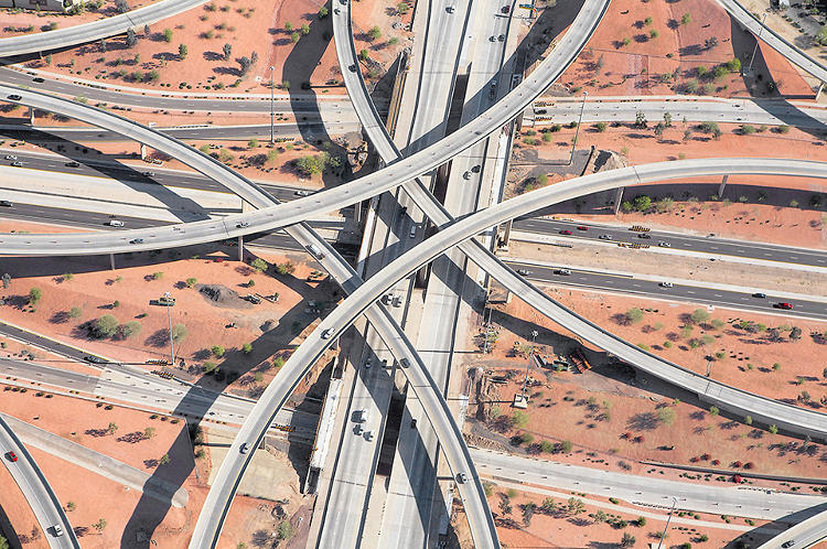 <p>A &quot;stack&quot; interchange framed against red soil.</p>