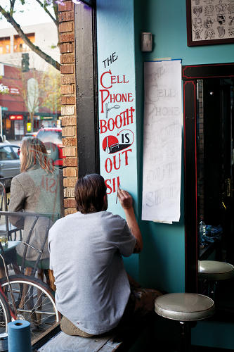 <p><em>Sign Painters</em>, a new book by Faythe Levine and Sam Macon, profiles the men and women whose hand-lettered handiwork can still be seen in small towns and big cities across the country. Here, Seattle's Sean Barton is hard at work.</p>