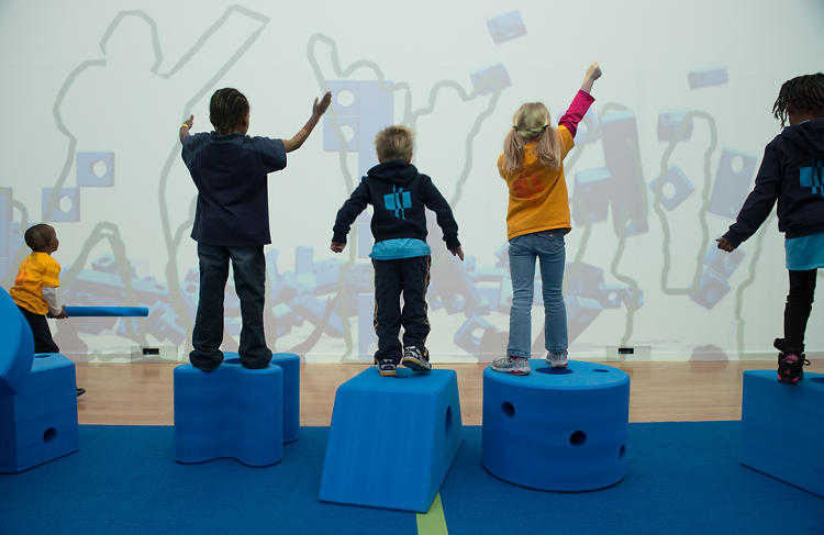 <p>In another area, Rockwell's digital interaction team, LAB, has designed an installation where jumping and dancing in front of a projector lets kids build and raze digital blue blocks.</p>