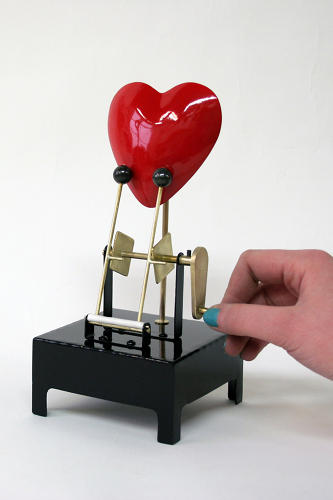 <p>A user-operated lever on the <a href=&quot;http://www.youtube.com/watch?v=xmscwbSJsoI&amp;feature=player_embedded&quot; target=&quot;_blank&quot;>Heart Machine</a> by Martin Smith gives this brass ticker a tinny beat.</p>