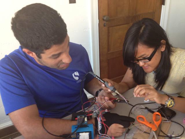 Elishai Ezra and Fransiska Hadiwidjana working on their robotic glove.