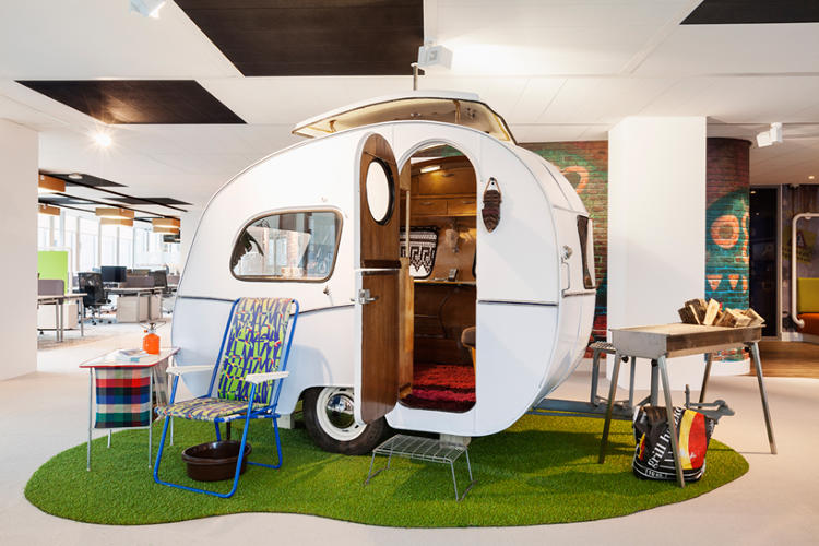 <p>Weirdly, some of the meeting rooms are in these mobile-home-type structures within the office, complete with lawn chair and grill.</p>