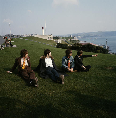 <p>John Lennon, Paul McCartney, George Harrison and Ringo Starr pose for a group shot, sitting on the grass at Plymouth Hoe looking out to sea on September 12th, 1967 during the filming of &quot;Magical Mystery Tour.&quot;</p>