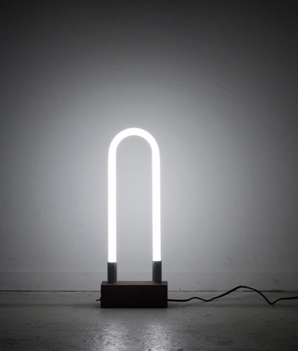 <p>Designer Sarah Pease used premade parts, most of which can be found in any hardware store, to make this fluorescent U-shaped light.</p>