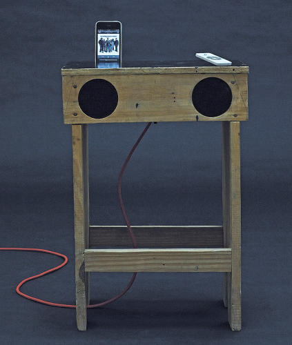 <p>The Radiola Table, by StudioMK27, is a bench table with speakers and an iPod dock made from wooden boards.</p>